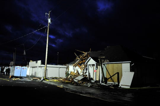 The Main Street area of Aumsville is filled with debris, insulation, bits of trees and roofing paper after being whipped around by the wind when a tornado hit Tuesday, Dec. 14, 2010.
