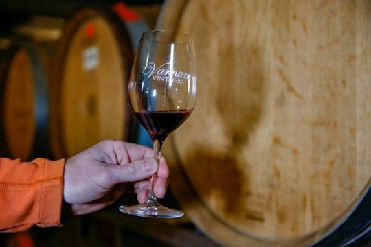 Cyler Varnum, of Varnum Vintners, displays his vineyard's 2019 Temperanillo Nouveau, at his vineyard in Amity, Ore. on Nov. 26.