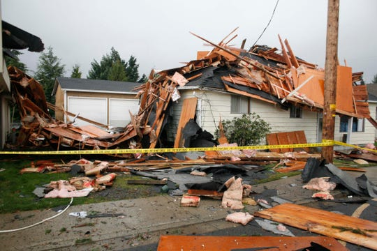 Damage to a house in on Sixth Street, between Main and Church streets that touched down in Aumsville on Tuesday, Dec. 14, 2010.