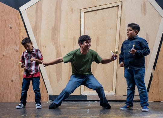 Diego Puga, middle, a sophomore at Alisal High School rehearses his big act during the La Posada Magica open to the media rehearsal night at the Alisal Center for the Fine Arts in East Salinas on Nov. 14, 2019. ÒBeing able to connect your issues to the character even though itÕs a fictional character, it's a pretty fun experience,Ó said Puga