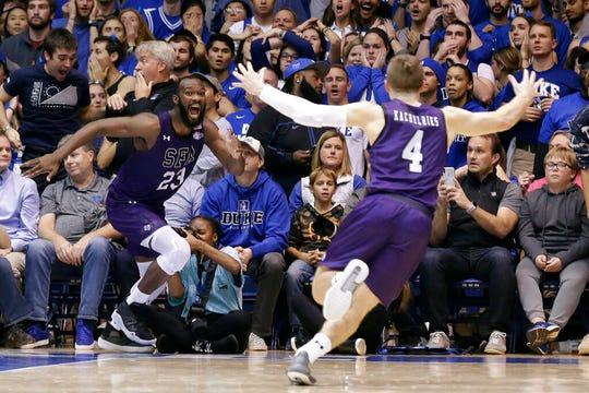 Stephen F. Austin forward Nathan Bain (23) and guard David Kachelries (4) celebrate Bain's game winning basket against Duke in overtime of an NCAA college basketball game in Durham, N.C., Tuesday, Nov. 26, 2019.