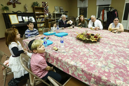 In this Nov. 8, 2019 photo, members gather for snacks after the service at the Temple Sons of Israel synagogue in DuBois Pa.  The small synagogue serves a very large region where the Jewish population is declining.