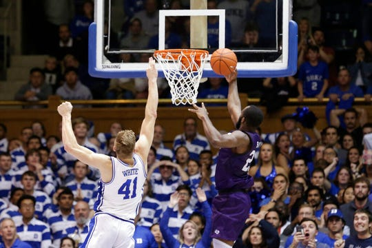 Stephen F. Austin forward Nathan Bain (23) drives for a game winning basket over Duke forward Jack White (41) during overtime in an NCAA college basketball game in Durham, N.C., Tuesday, Nov. 26, 2019. Stephen F. Austin won 85-83.