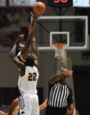 University of Maryland Eastern Shore guard Gabriel Gyamfi goes against Wofford College forward Chevez Goodwin for the opening tip-off on Tuesday, Nov. 26, 2019.