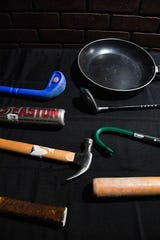 Smashing weapons are displayed on a table for the client's choosing on Wednesday, Nov. 27, at Escapades Escape Rooms in Sioux Falls.