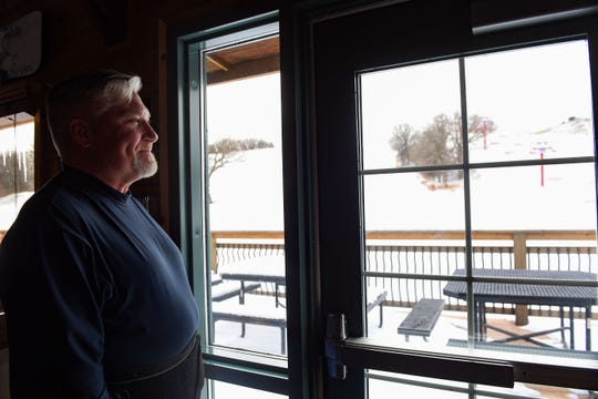 Dan Grider, general manager at Great Bear Ski Valley, looks at the fresh snow on Wednesday, Nov. 27, in Sioux Falls.