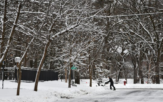 Snow coats trees and fences as residents clear sidewalks of snow Wednesday, Nov. 27, 2019, in St. Cloud. According to the National Weather Service, St. Cloud received four inches of snow overnight.