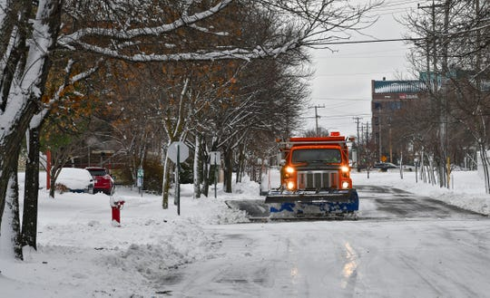A snowplow removes about four inches of snow from a city street Wednesday, Nov. 27, 2019, in St. Cloud.