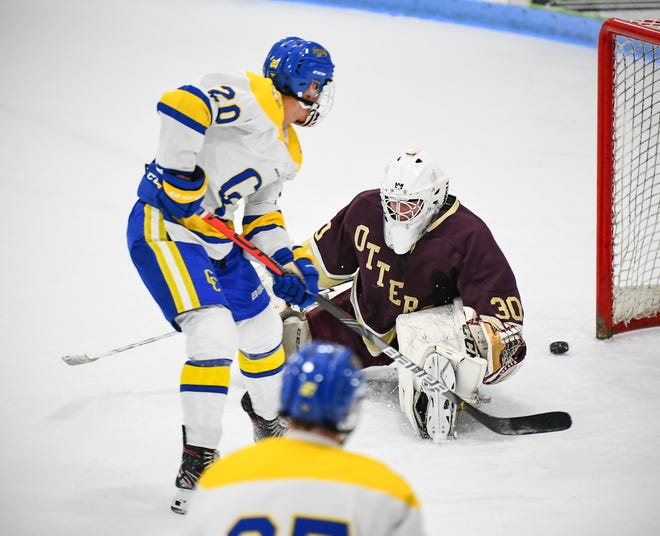 Cathedral's Jack Smith gets the puck past Fergus Falls goaltender Ian Stumbo during the Tuesday, Nov. 26, 2019, game at the MAC in St. Cloud.