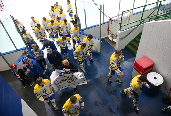 Cathedral players leave the ice following a banner ceremony before the start of the Tuesday, Nov. 26, 2019, game against Fergus Falls at the MAC in St. Cloud.