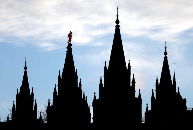 FILE - In this Jan. 3, 2018, file photo, the angel Moroni statue, silhouetted against the sky, sits atop the Salt Lake Temple at Temple Square in Salt Lake City. Utah is set to become the 19th state to enact a ban on the discredited practice of conversion therapy after state officials revised a proposal to win back the support of the influential Church of a Jesus Christ of Latter-day Saints. (AP Photo/Rick Bowmer, File)