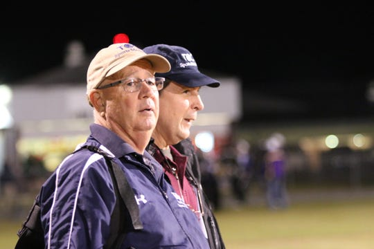 Tallahassee Orthopedic Clinic certified athletic trainer Jim Watson (tan hat) and orthopedic surgeon Dr. Floyd Jaggears watch during a recent Madison County football game.