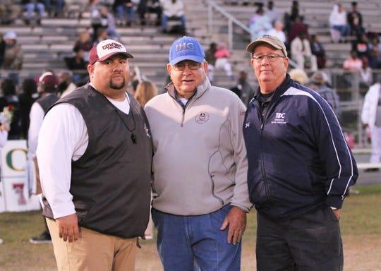 Madison County head coach Mike Coe, former FSU defensive coordinator Mickey Andrews, and Tallahassee Orthopedic Clinic certified athletic trainer Jim Watson pose for a photo before a recent game.