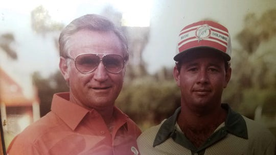 Tallahassee Orthopedic Clinic certified athletic trainer Jim Watson (right) with Miami Dolphins coach Don Shula.