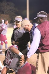 Tallahassee Orthopedic Clinic certified athletic trainer Jim Watson works on the sidelines during a Madison County football game.