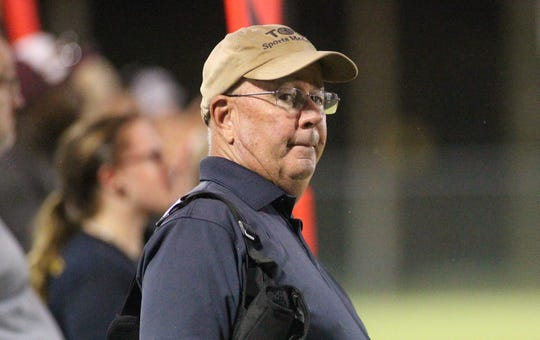 Tallahassee Orthopedic Clinic certified athletic trainer Jim Watson on the sidelines during a game in Wakulla.