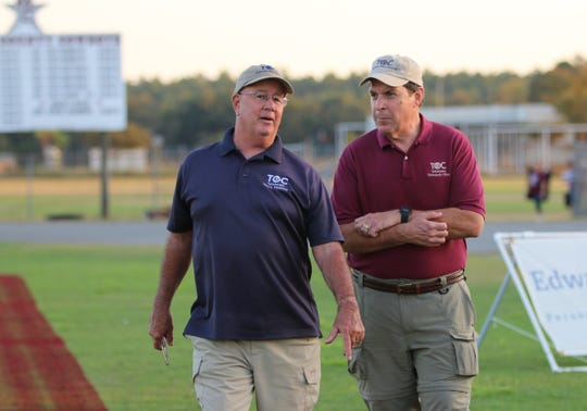 Tallahassee Orthopedic Clinic certified athletic trainer Jim Watson (left) and orthopedic surgeon Dr. Floyd Jaggears hang out before a game at Madison County's Boot Hill Stadium.