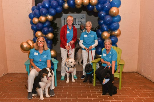 Pet therapy volunteers Laurie Volpe with Luke, left, Nancy Bowden with Sydney, Kitty Reading with Schatzi and Terry Wood with Ellie at the HSTC Homecoming Party on Nov. 16, 2019, in Stuart.