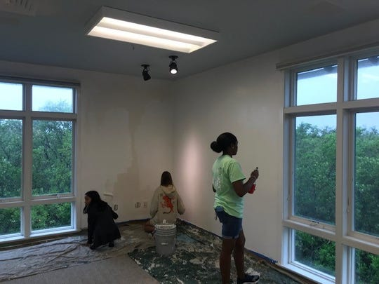 Kiwanis Youth in Action members paint a room at the Environmental Learning Center on Nov. 9, 2019.