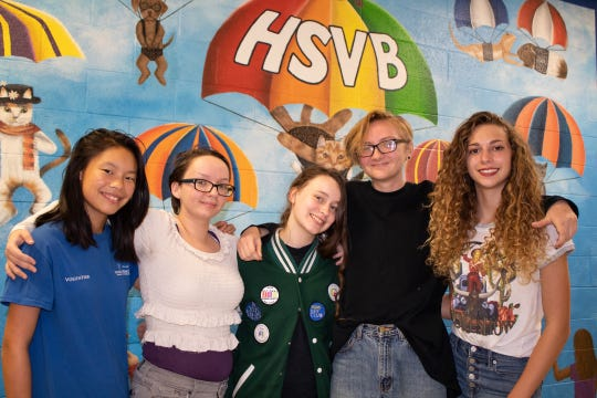 Indian River Charter High School students, led by artist Summer Foster, left, painted this mural on the wall of the cat room at the Humane Society of Vero Beach and Indian River County. Pictured with Foster are Caitlyn Stutsman, Kelsey Jones, Aaron Black and Ally Hannan.