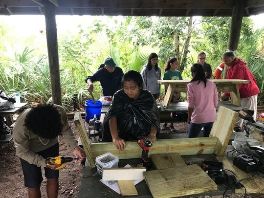 Despite the pouring rain, about 60 Kiwanis Youth in Action members gathered at 8 a.m. Nov. 9, 2019, at the Environmental Learning Center near Wabasso. Under the direction of Kiwanis members, this crew built 20 benches to be placed around the property for visitors to use.