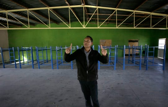 Pasos de Fe migrant shelter director Miguel Gonzalez shows a large room at his shelter that he is converting into living space in case more asylum seekers show up in Juárez.
