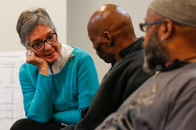 Wausau city councilwoman Linda Lawrence talks with Chris Norfleet and David Deon Stuart, co-founders of People for the Power of Love, on Tuesday, November 26, 2019, at Wausau City Hall in Wausau, Wis. Protestors were there to address racially charged remarks made in 2003 by Lawrence when she was mayor of Wausau.
