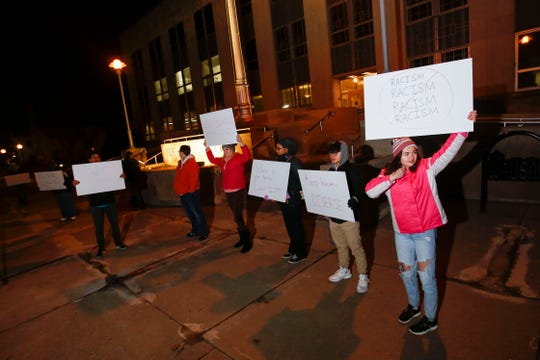 Protestors hold up signs endorsing racial diversity on Tuesday, November 26, 2019, at Wausau City Hall in Wausau, Wis. Protestors were there to address racially charged remarks made in 2003 by recently-appointed city councilwoman Linda Lawrence when she was mayor of Wausau.