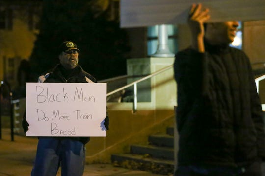 Milton Esco holds up a sign endorsing racial diversity on Tuesday, November 26, 2019, at Wausau City Hall in Wausau, Wis. Protestors were there to address racially charged remarks made in 2003 by recently-appointed city councilwoman Linda Lawrence when she was mayor of Wausau.