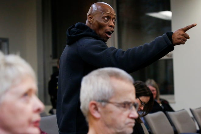 Chris Norfleet, co-founder of People for the Power of Love, points his finger at the city council during a public comment session on Tuesday, November 26, 2019, at Wausau City Hall in Wausau, Wis. Protestors were there to address racially charged remarks made in 2003 by recently-appointed city councilwoman Linda Lawrence when she was mayor of Wausau.