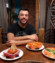 Paul Russo, one of the owners of TVB by: Pax Romana in White Plains Nov. 25, 2019. The Italian restaurant is known for its generous pours and substantial food offerings at Happy Hour.