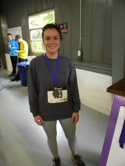 Jocylen Roberts poses with her medal after a 5K.