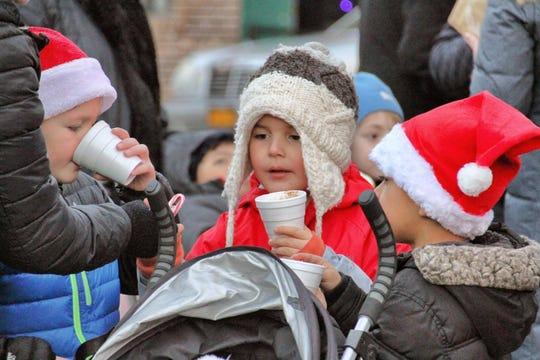 Kids sip hot chocolate in Nyack.