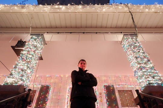 Austin Lemmon has set up a computerized light display at his home on Lindbergh Avenue in Zanesville. He and his brother Brandon have expanded the display every year since they started the light display three years ago.