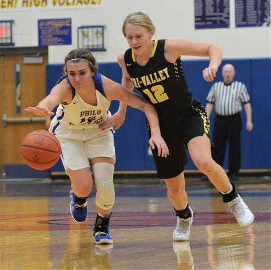 Philo's Joleigh Harrop and Tri-Valley's Audrey Spiker battle for a lose ball in the Scotties' 63-32 win on Tuesday at The Power Plant.