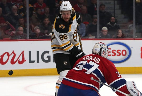Nov. 26: Boston Bruins right wing David Pastrnak scores a goal against Montreal Canadiens goaltender Keith Kinkaid for his second hat trick of the season.