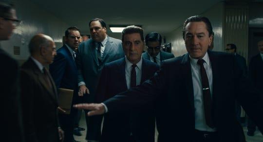 "Frank Sheeran (Robert De Niro, right) is best friend and bodyguard to union leader Jimmy Hoffa (Al Pacino) in ""The Irishman."""