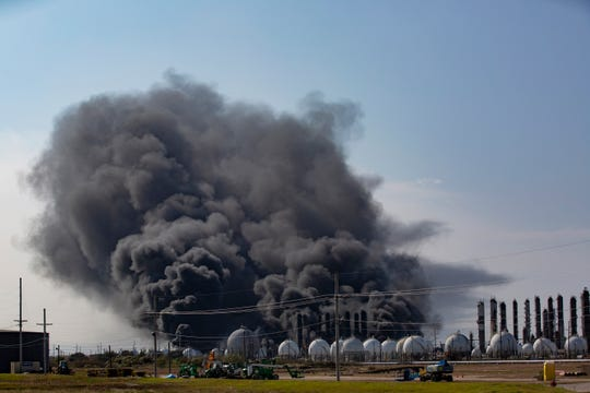 Smoke rises from an explosion at the TPC Group Port Neches Operations plant on Wednesday, Nov. 27, 2019, in Port Neches, Texas.