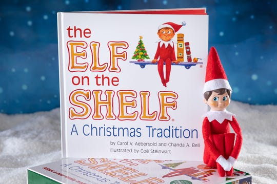"""""""The Elf on the Shelf"""" book and doll."""