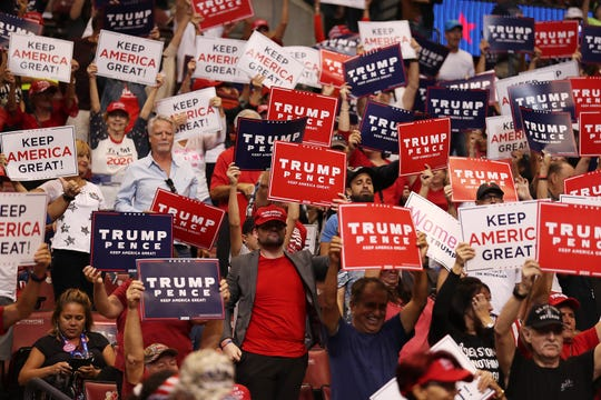 People wait for the arrival of President Donald Trump for his homecoming campaign rally at the BB&T Center on Nov. 26, 2019, in Sunrise, Fla.