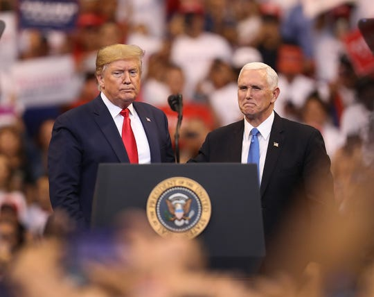 President  Trump and Vice President Mike Pence stand together during a homecoming campaign rally at the BB&T Center on Nov. 26, 2019, in Sunrise, Fla.