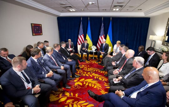 This handout picture taken and released by Ukrainian presidential press-service on September 1, 2019, shows Vice President Mike Pence and Ukrainian President Volodymyr Zelensky holding talks next to their delegations in Warsaw.