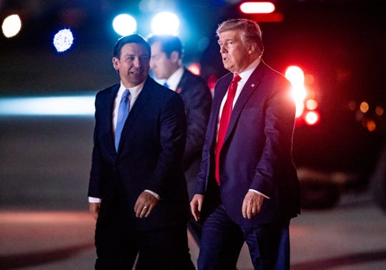President Trump arrives on Air Force One greeted by Florida Governor Ron DeSantis at Palm Beach International Airport in West Palm Beach, Fla on Nov. 26, 2019.