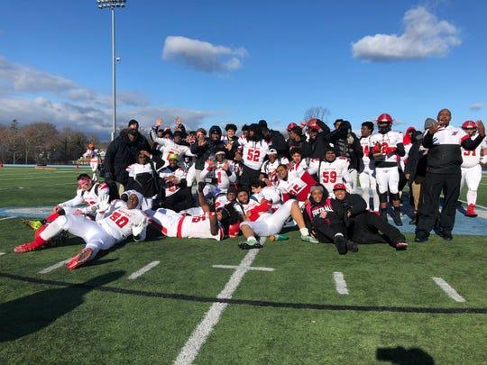 The Neptune football team celebrates the 2019 Thanksgiving Day win over Asbury Park on Nov. 28, 2019.