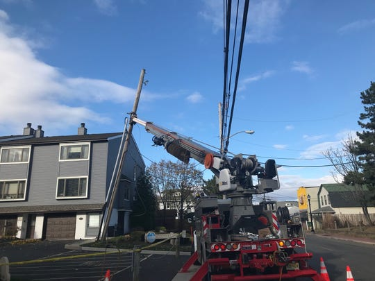 The arm of a JCP&L truck was holding up a utility pole on Bay Avenue in Highlands after high winds blew it down on Nov. 28, 2019, knocking out power to the Baypointe Condominiums