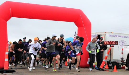The fastest runners at the front check to make sure their watch timers started as the 16th annual Abilene Turkey Trot begins Thursday at Shotwell Stadium. Participants ran, jogged or walked a 5K course in southeast Abilene.