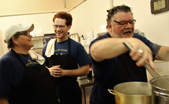 While Alan Jones stirs the gravy, son Griffin, a theater major at Abilene Christian University, and sister Angela share a laugh. The Joneses have volunteered for seven of the eight years that Lucy's Big Burgers has offered Abilene a free Thanksgiving meal. They arrived early to prepare the corn, green beans and gravy.