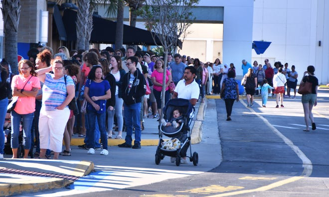 At a J.C. Penney in Merritt Island, Florida, shoppers started lining up before noon for a coupon giveaway. By the time the store opened at 2 p.m., hundreds had lined up.
