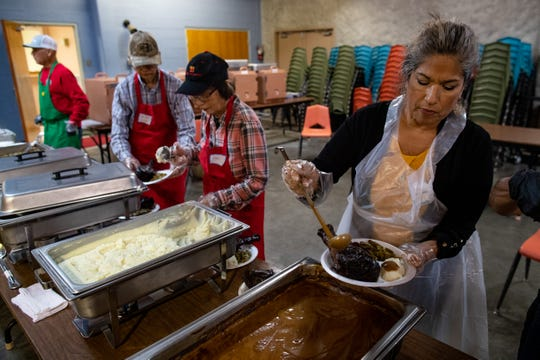 Volunteers plate meals for guests during the 76th annual Joe Salem Thanksgiving dinner held at Sokol Corpus Christi Gym on Thursday, Nov, 28, 2019.