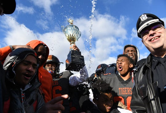 The Whip Wilson Turkey Bowl Trophy is presented to the Woodrow Wilson High School football team after Woodrow Wilson defeated Camden, 72-8, in the Thanksgiving Day football game played at Woodrow Wilson High School in Camden on Thursday, November 28, 2019.